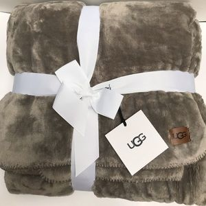 Brand New!  UGG throw in Seal color